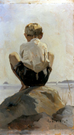 A Boy Crouching On A Rock