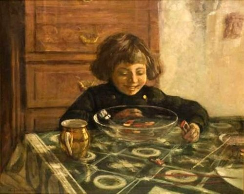 A Child Sitting At The Table