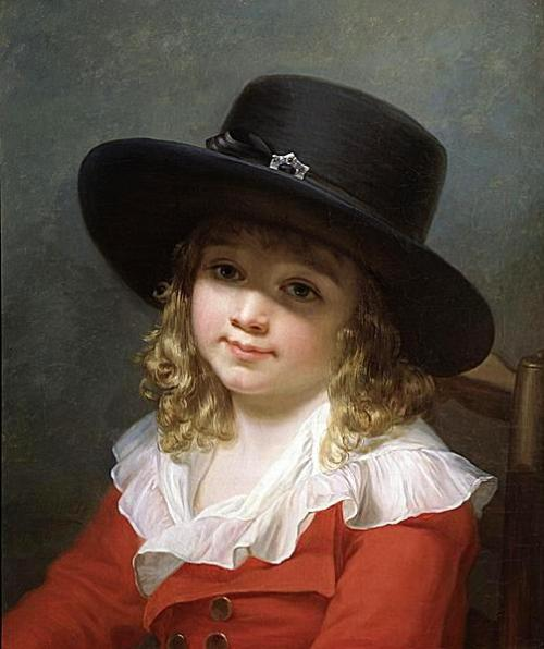 A Young Boy Wearing A Black Hat