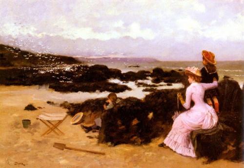 Femme et enfants sur la plage