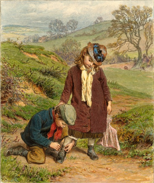 Boy Tying A Girl's Shoe