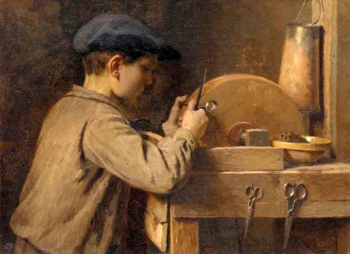 A Young Boy Grinding Scissors