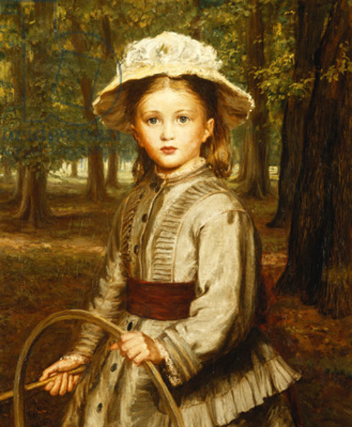A Young Girl Playing With A Hoop