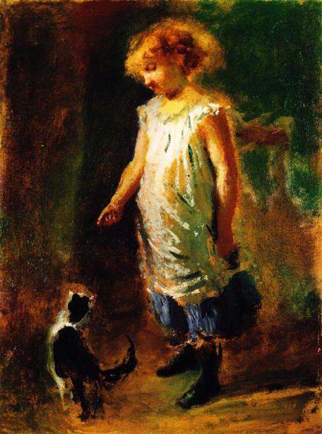 Bambina che gioca col gatto