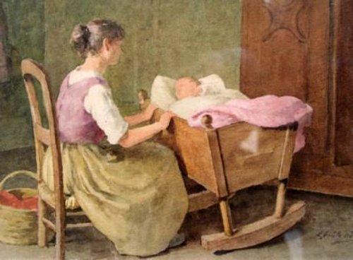 Mère berçant son bébé