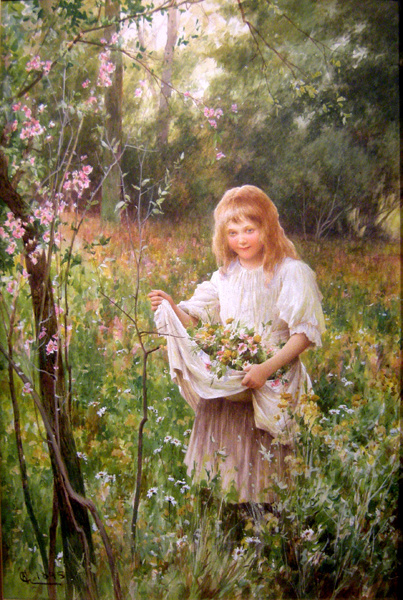 Little Girl Gathering Flowers On A Meadow