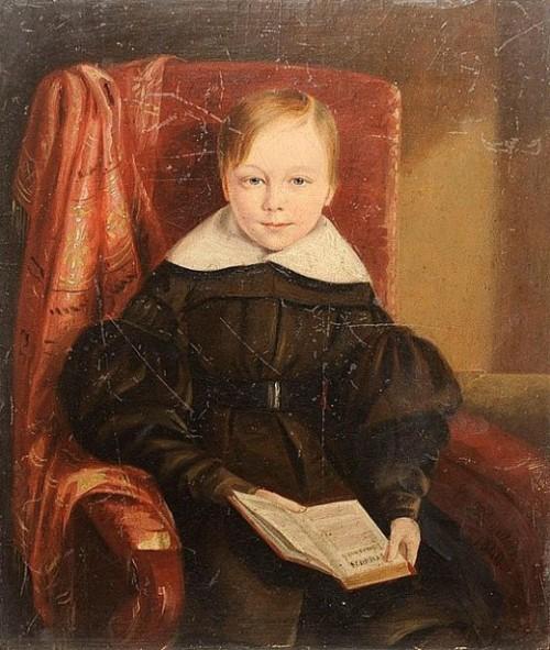 A Boy Holding A Hymn Book