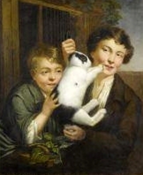 Two Boys Playing With A Rabbit