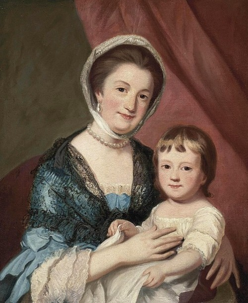 A Lady Holding A Child