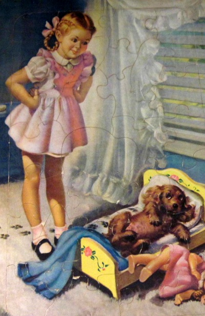 Little Girl Finds Her Puppy In Bed